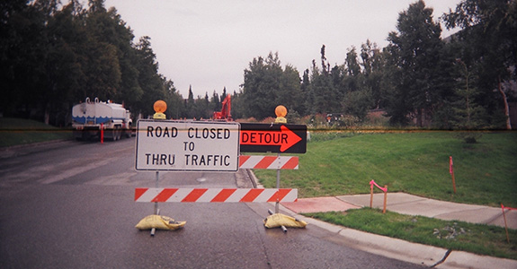 Road closed to thru traffic detour sign